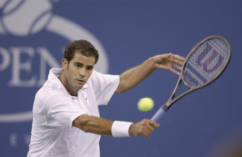 FLUSHING-SEPTEMBER 5: Pete Sampras (USA)hits a backhand against Andre Agassi (USA) during the US Open at the USTA National Tennis Center on September 5, 2001 in Flushing Meadows Corona Park in Flushing, New York. (Photo by Clive Brunskill/Getty Images)