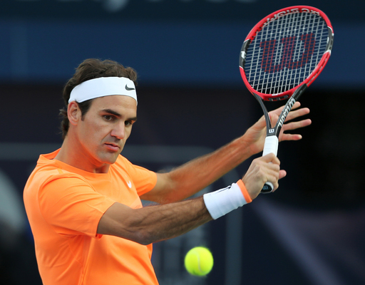 Roger Federer of Switzerland returns the ball to Borna Coric of Croatia during a semi final match of the Dubai Duty Free Tennis Championships in Dubai, United Arab Emirates, Friday, Feb. 27, 2015. (AP Photo/Kamran Jebreili)